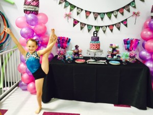 girl doing gymnastic exercise standing next to party arrangements